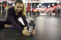 a woman stretching in the gym