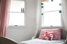twin bed in a girl's bedroom.