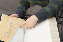 toddler finger pointing to a map of the middle east in a Bible