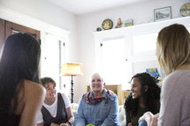 woman's group Bible study having a discussion in a living room