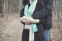 man and a woman hugging outdoors