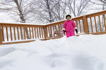 toddler girl in snow