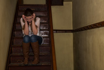 frustrated teen girl sitting on stairs