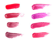 Collage of Lipsticks Smears in Various Colors on a White Background