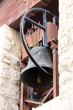 Bell in a stone bell tower.