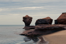 rock formations and rocks along a shoreline