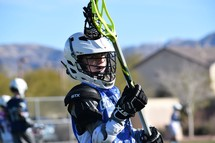 lacrosse player warming up before a game