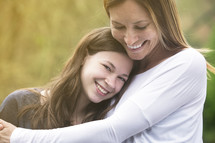 mother and teen daughter hugging
