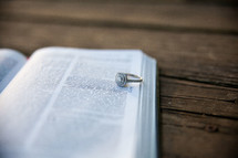 engagement ring on the pages of a Bible