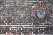 circular window in a brick wall
