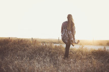 a young woman walking in the sunset