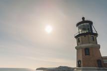 a lighthouse at daybreak