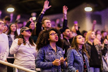 A congregation of young people at a worship service.