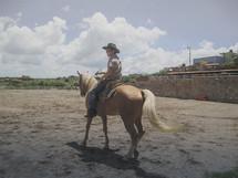 A cowboy riding a horse.