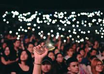 cellphone lights lighting up a concert crowd