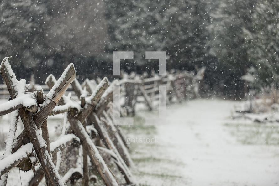 snow on a fence line