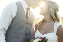 portrait of a bride and groom and intense sunlight