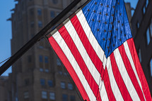 American flag in a city