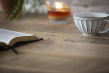 tea, Bible, and candle on a table