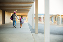 Back to school, sister walking little sister to school, holding hands, friends, relationship, school, campus, siblings, hallway