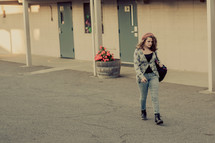 Young Teenage girl walking alone on a school campus, sad, loneliness, student, youth