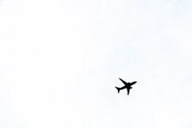 silhouette of an airplane in flight