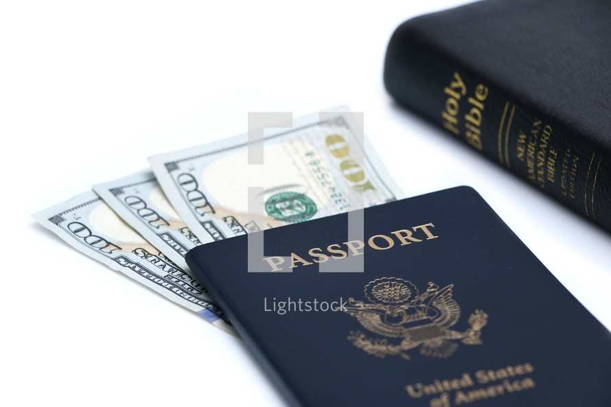 cash and American passports on a white background