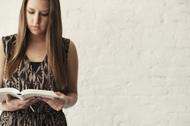 young woman reading a Bible