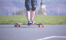 a teen boys feet on a skateboard