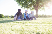 friends sitting in the grass talking