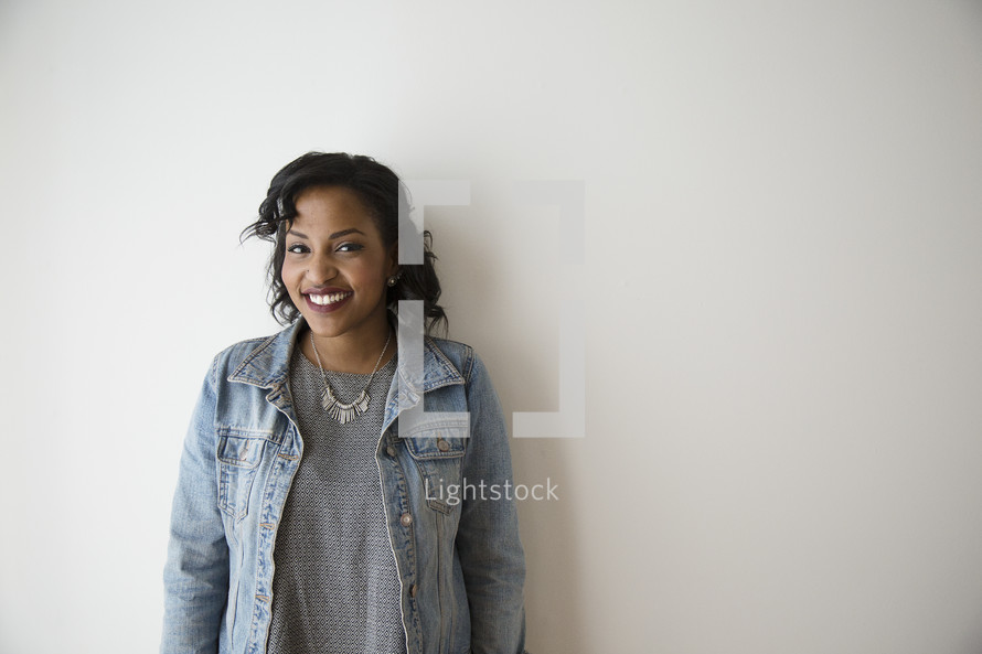 portrait of an African American woman leaning against a wall