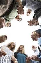 family holding hands in prayer