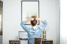 a frustrated woman sitting in front of a laptop