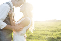 portrait of a bride and groom under intense sunlight