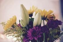 white, purple, yellow, flower arrangement