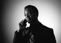An African American businessman talking on a cellphone