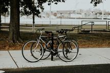 bikes on a bike rack at a park