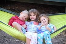 siblings on a hammock