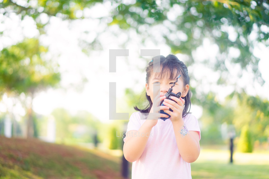 child with a walkie talkie