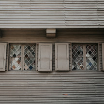 shutters and stained glass windows on a house