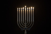 lit candles on a menorah.