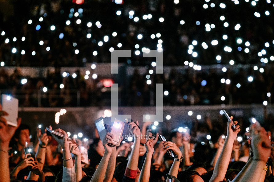 cellphones taking pictures at a concert