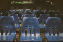 Blue plastic chairs in rows