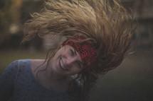 A girl with wild hair and a headband