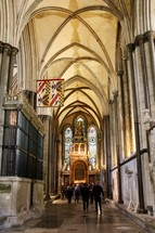 people walking in a cathedral hall