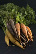 carrots on a black background