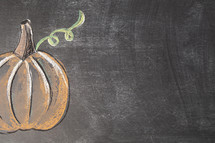 pumpkin on chalkboard