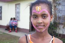 girl child with a painted face