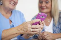 an elderly woman holding a cellphone