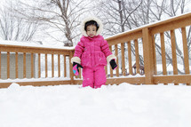 a toddler in a snowsuit
